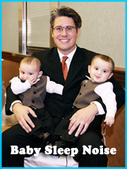 photo of dad with his twins boys in his lap